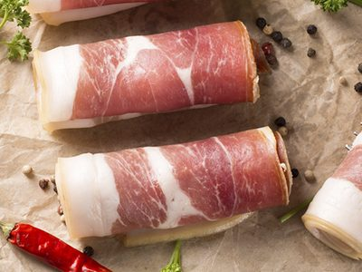 Fresh Prosciutto Rolled and Prepared by a Quality Italian Deli Cook