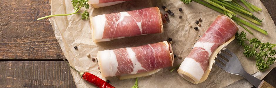 Fresh Prosciutto Rolled and Prepared by a Quality Italian Deli Cook
